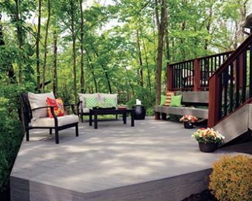 Wood deck surrounded by green tress