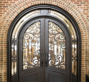Dark brown, rounded arch door with stained glass windows