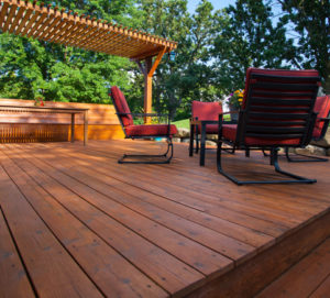 Wood deck and red chairs
