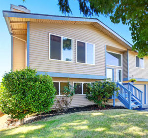 Exterior of beige siding house with blue trim