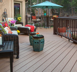 Dark wood deck and dark green chairs