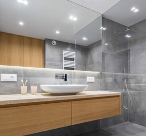 Luxury bathroom with large glass mirror and wood sink