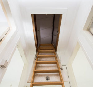 Wood stairs leading to the attic