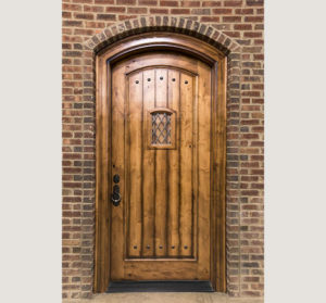 Exterior wood door on a brick house